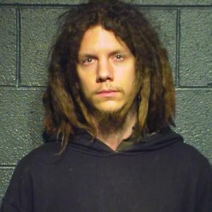 Imagem do Departamento de Polícia de Chicago após a prisão de Jeremy Hammond; Ele é suspeito de ser um dos membros do grupo hacker Anonymous